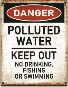 Weathered metallic placard with danger polluted water warning text_vector